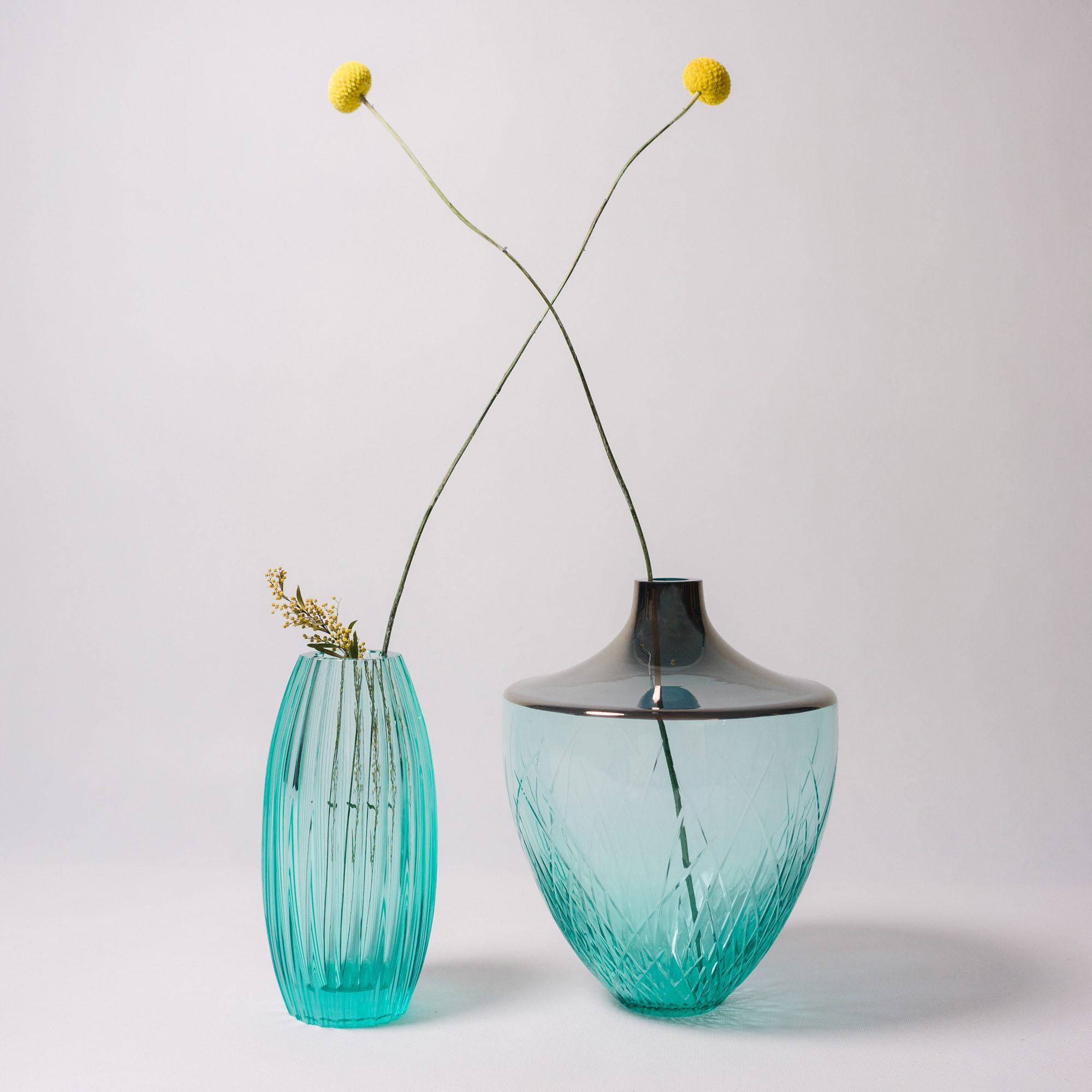 Aquamarine hand cut crystal vase with flowers