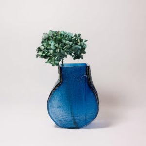 Blue glass vase with flowers by Sebastian Kitzberger