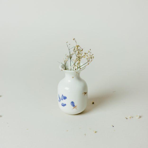 Small handmade vase with flower illustration