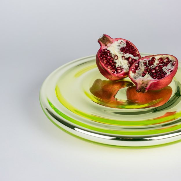 Pomegranate on uranium glass serving bowl by Michal Prazsky