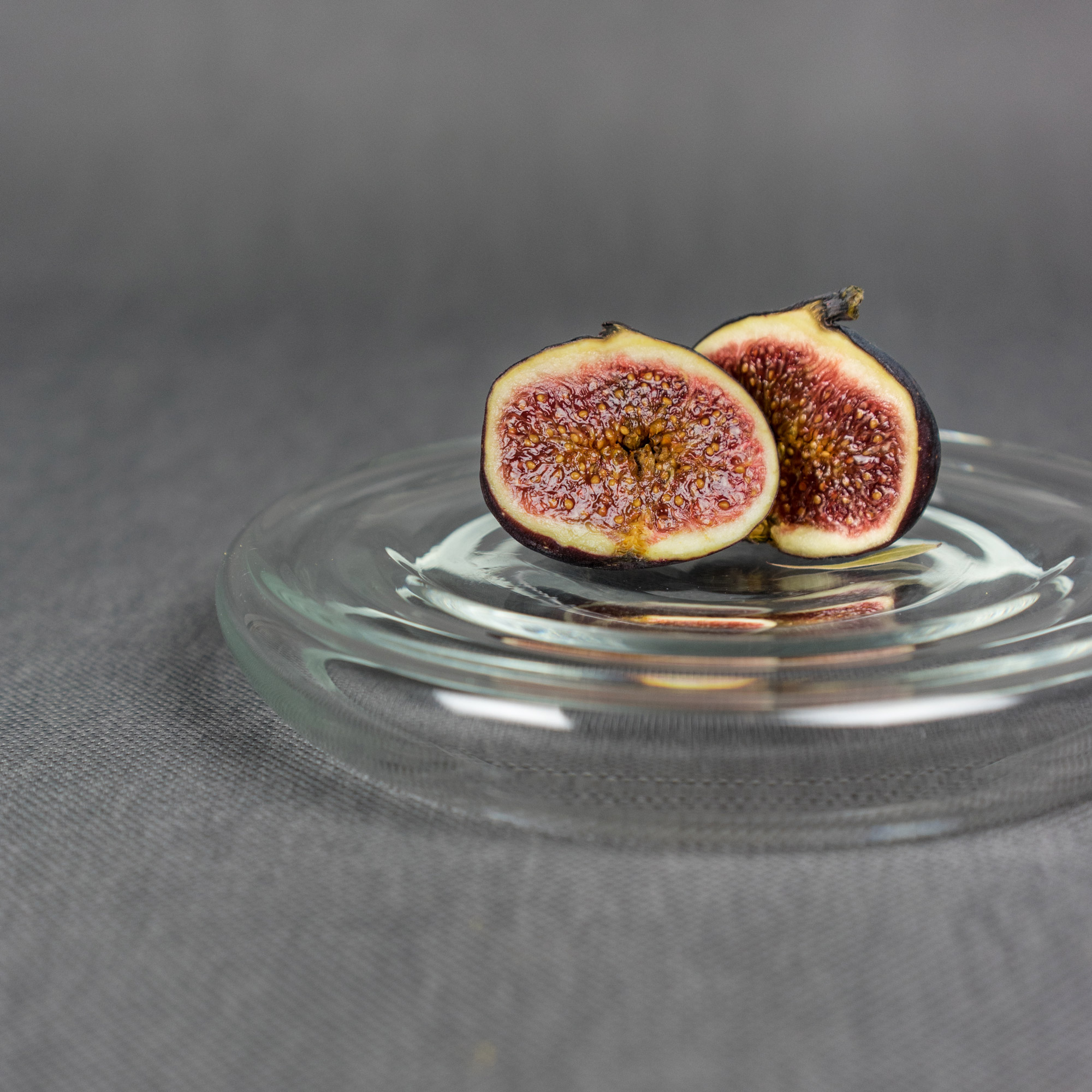 Figs on clear glass serving tray by Michal Prazsky
