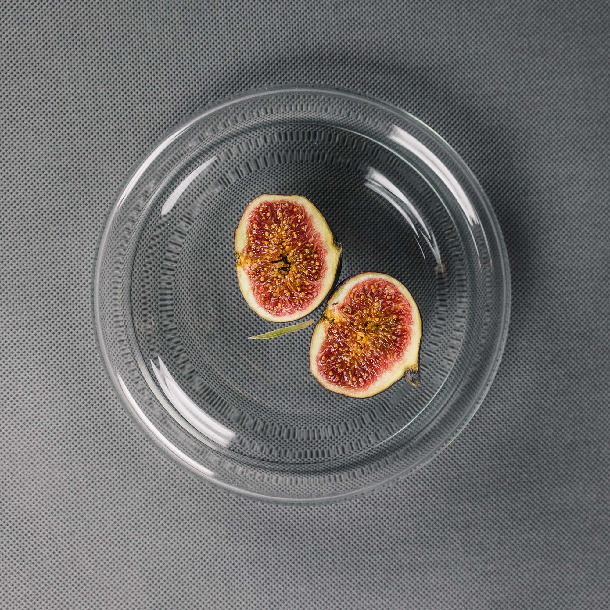 Small clear glass bowl with figs by Czech designer Michal Prazsky
