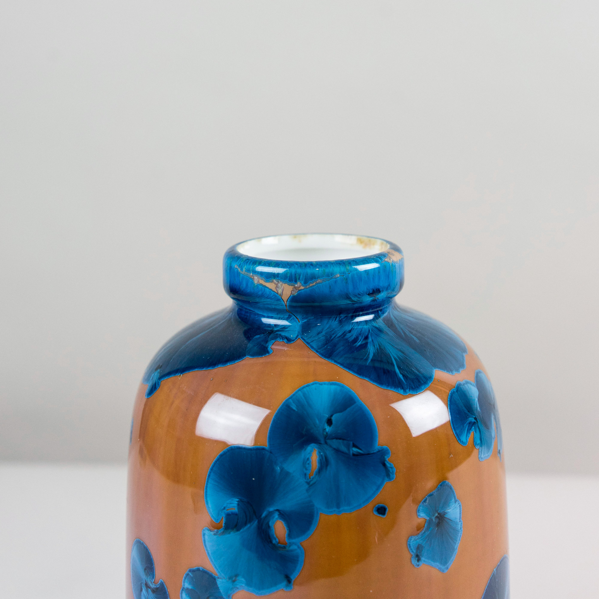Half of dark amber vase with blue crystallines by Milan Pekar