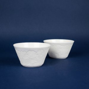 Two white ceramic structure bowls by Czech design studio Nalejto