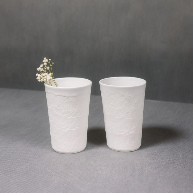 Two white ceramic structure cups by Nalejto