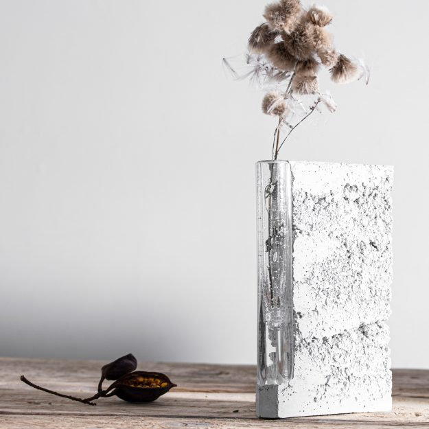 Grey concrete vase with glass cylinder inside by Prasklo design studio