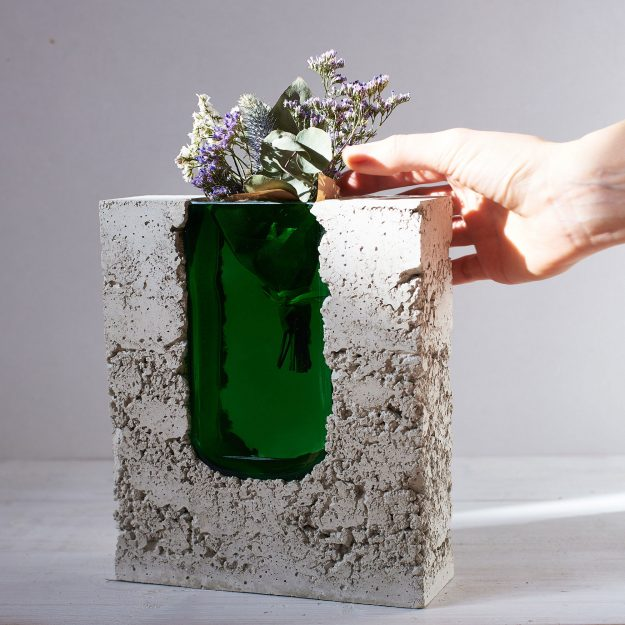 Concrete vase with green see-through glass for flowers by Prasklo design studio