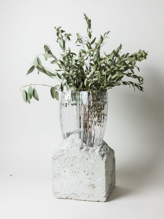 Concrete and glass vase with green flowers by Prasklo