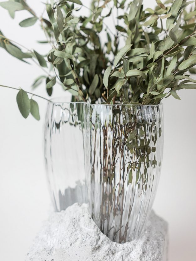Concrete and glass vase with flowers by Prasklo