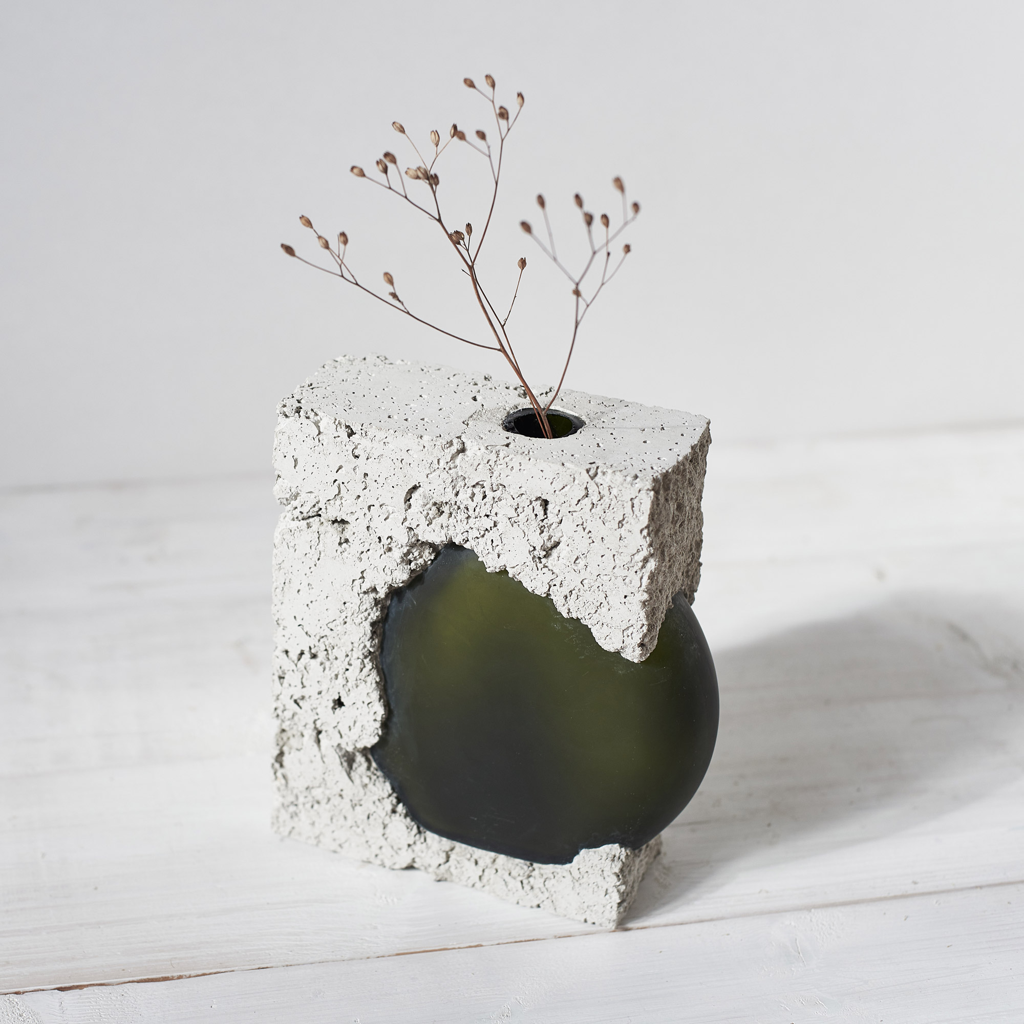 Concrete vase with green glass and flowers handmade by Prasklo design studio