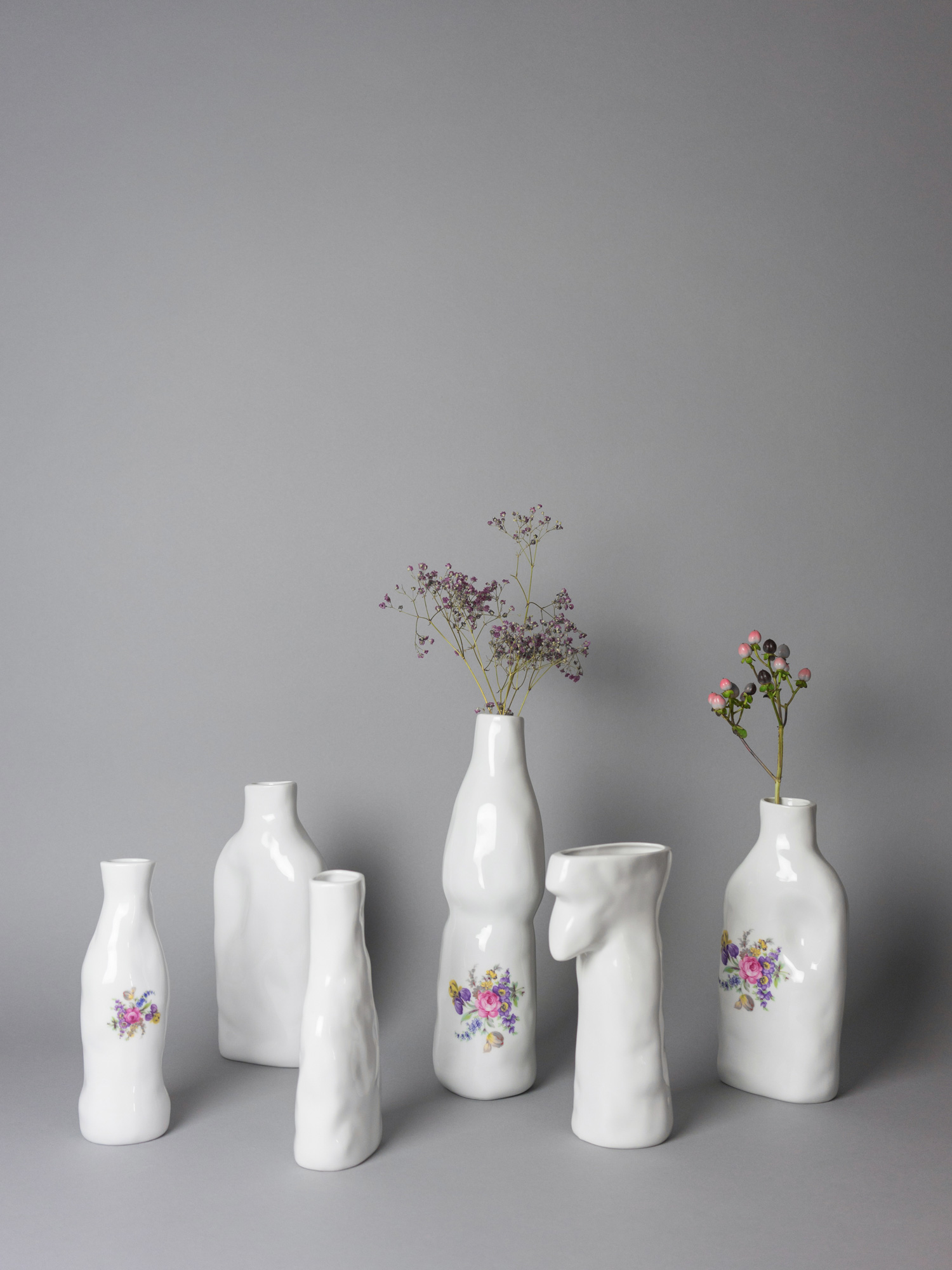 Porcelain abstract vases with flower pattern by Qubus design studio