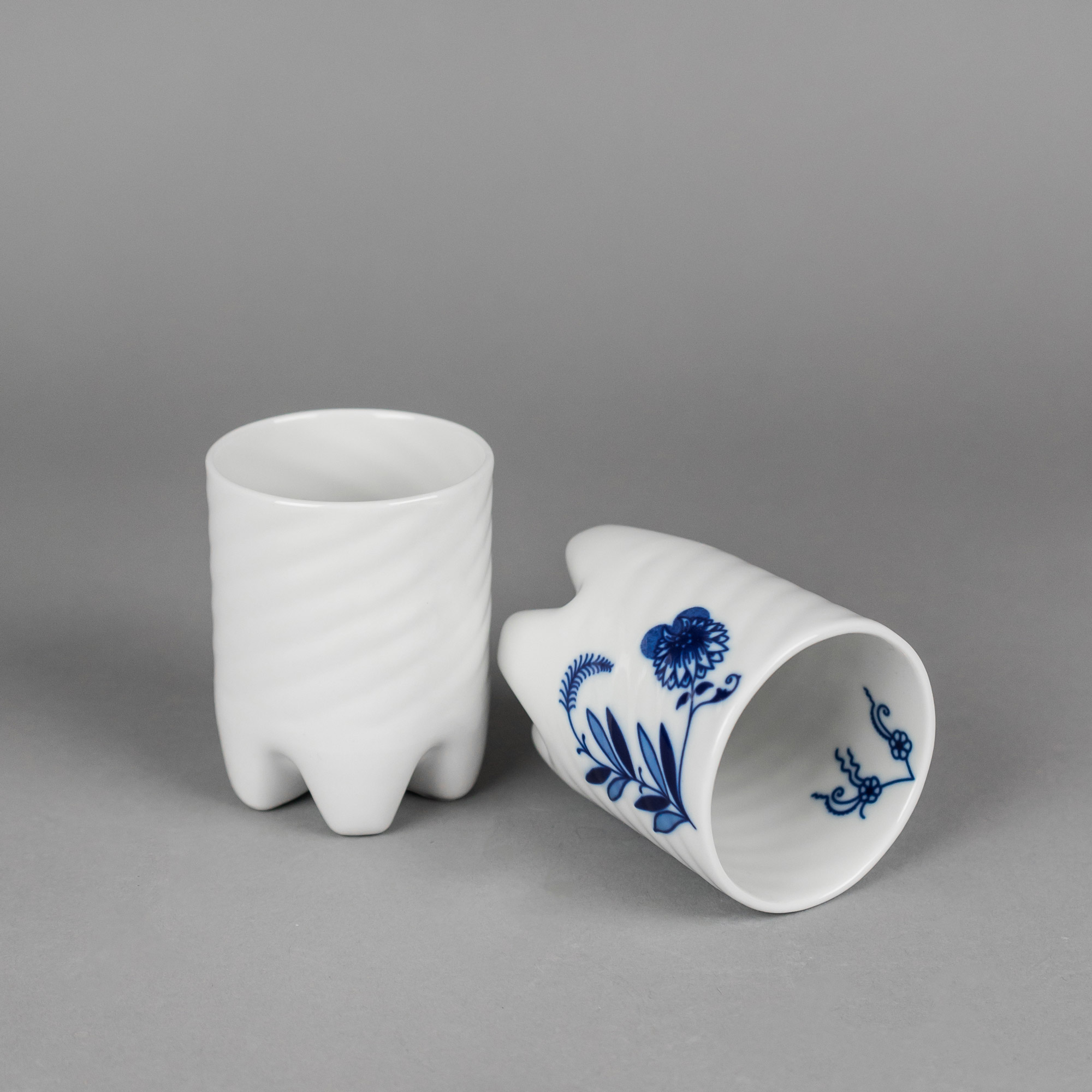 White and onion pattern porcelain cup on grey background by Qubus design studio