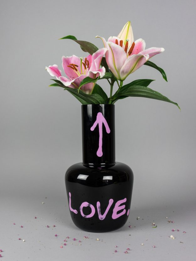 Black glass vase with Love print and pink Lillies
