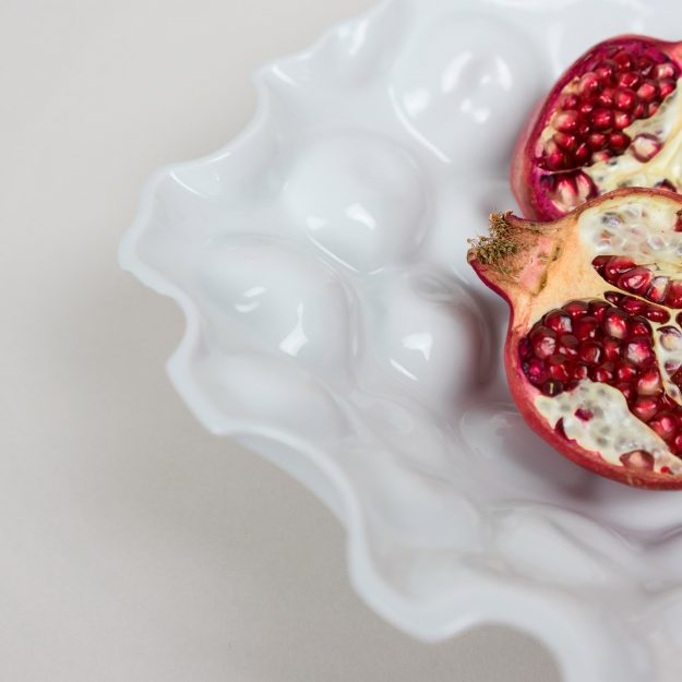 Detail of porcelain bowl by Tyformy with pomegranate