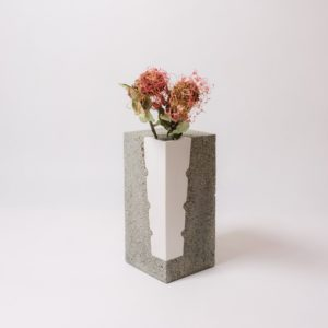 White porcelain vase encapsulated in concrete by Vobouch designers with red dry flowers 02