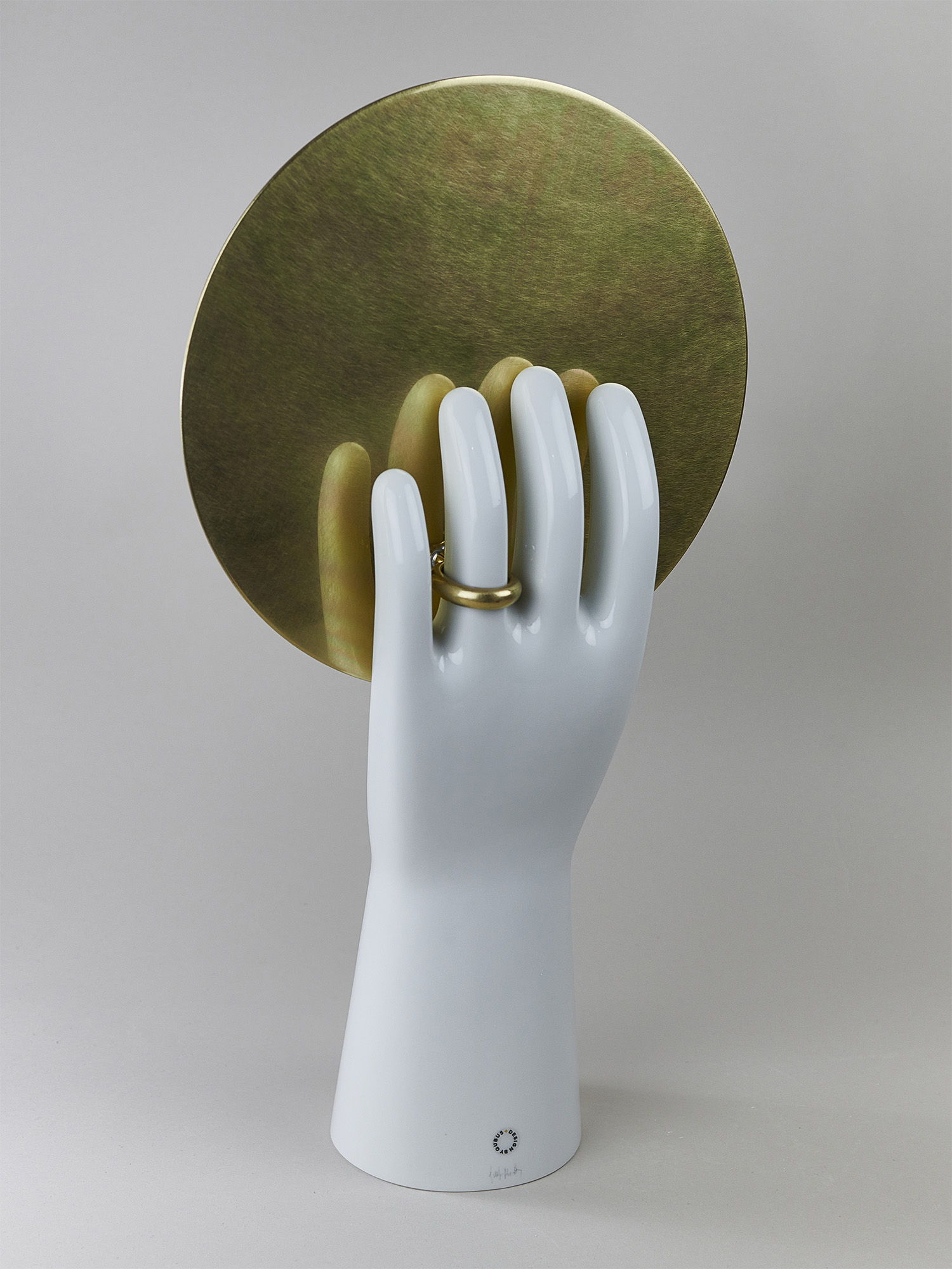 A mirror in a porcelain hand by Qubus design studio