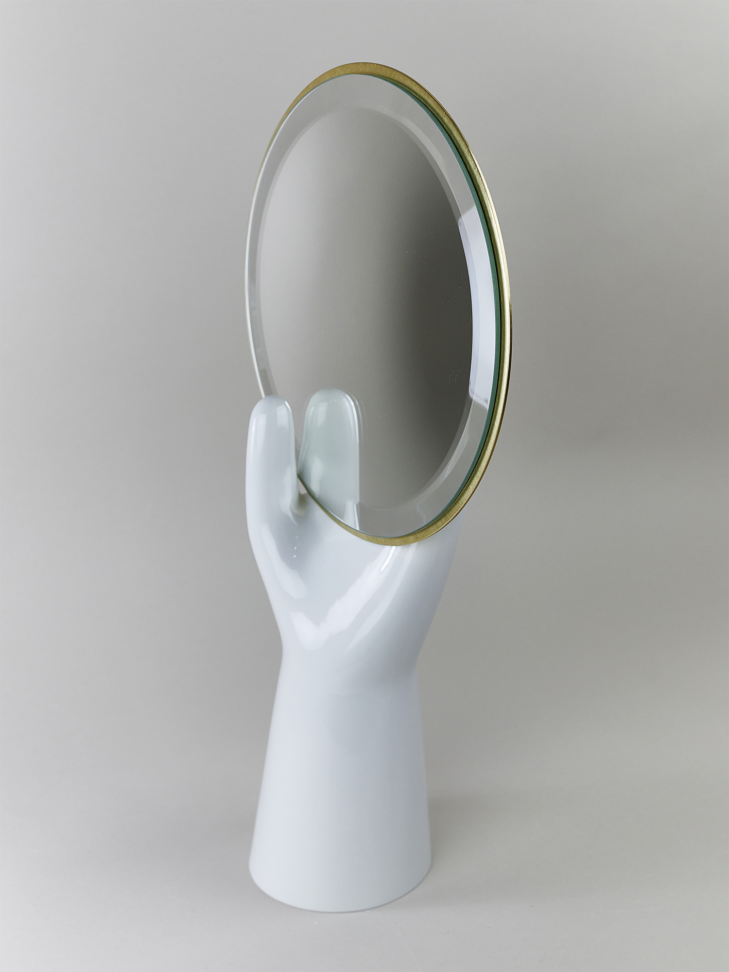 A porcelain hand with mirror by Qubus design studio
