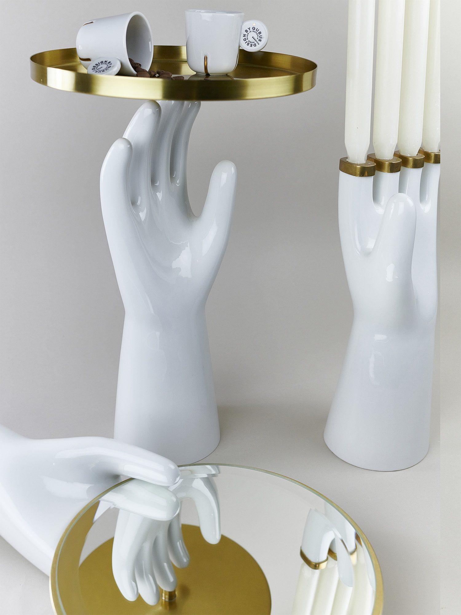 A set of porcelain hands by Qubus design studio