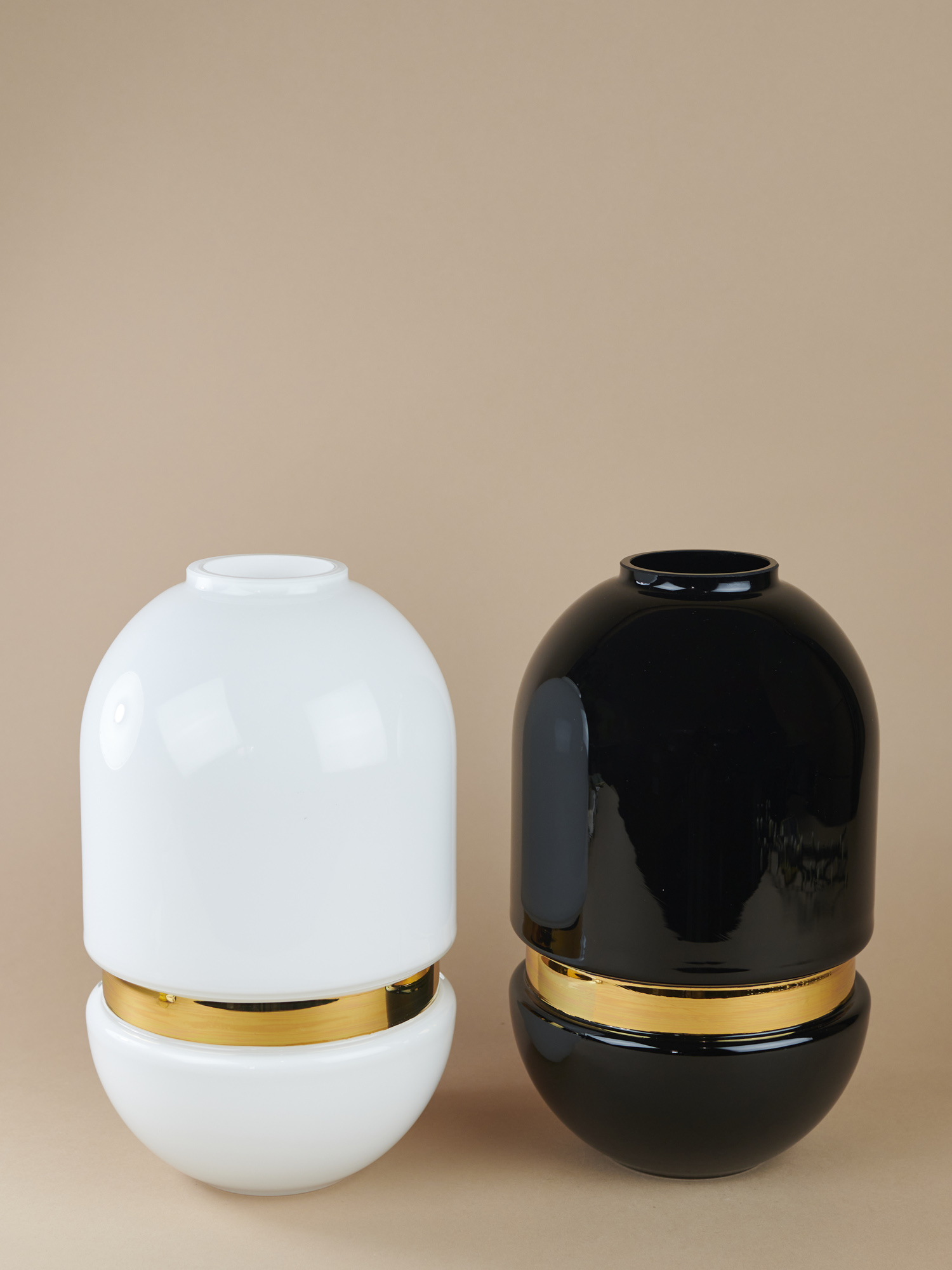 Black and white glass vases with golden stripe in the middle by Pavel Vytisk