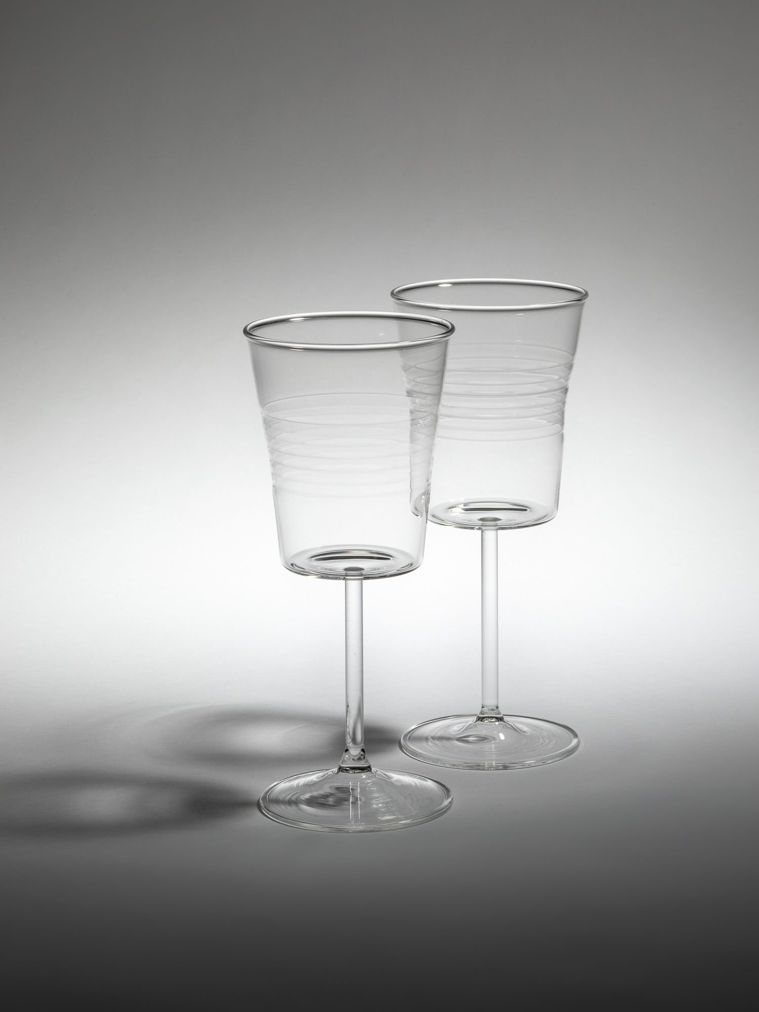 Two transparent glass wine glasses by Qubus