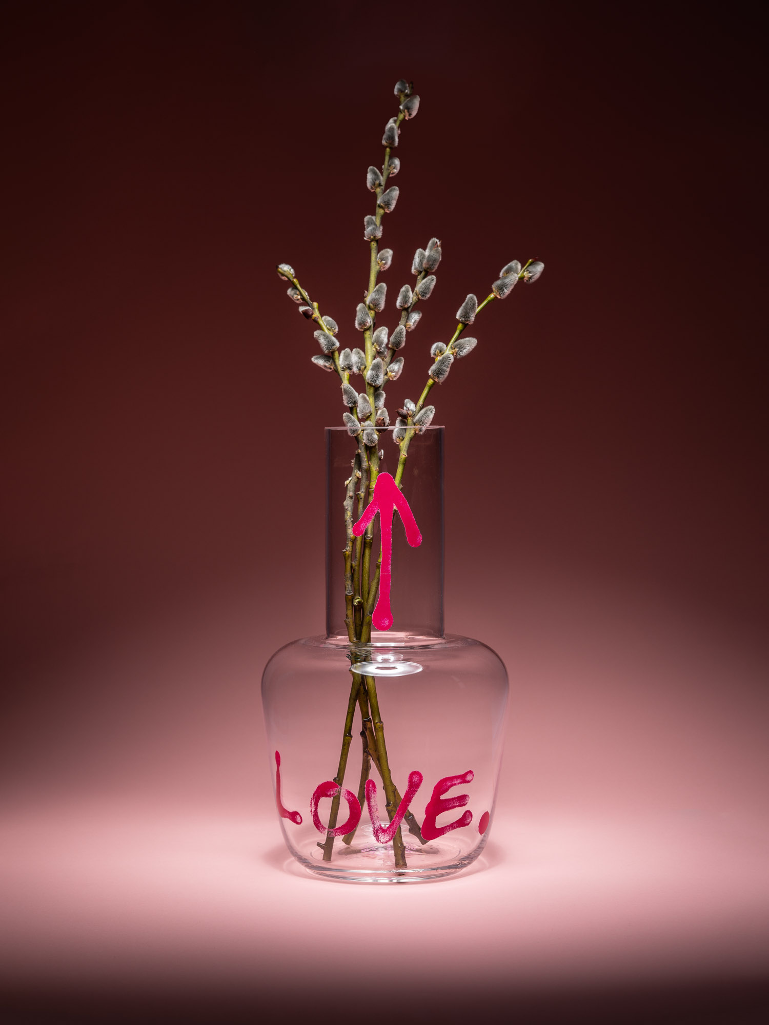 Transparent Love vase by Qubus with pink graffiti and flowers