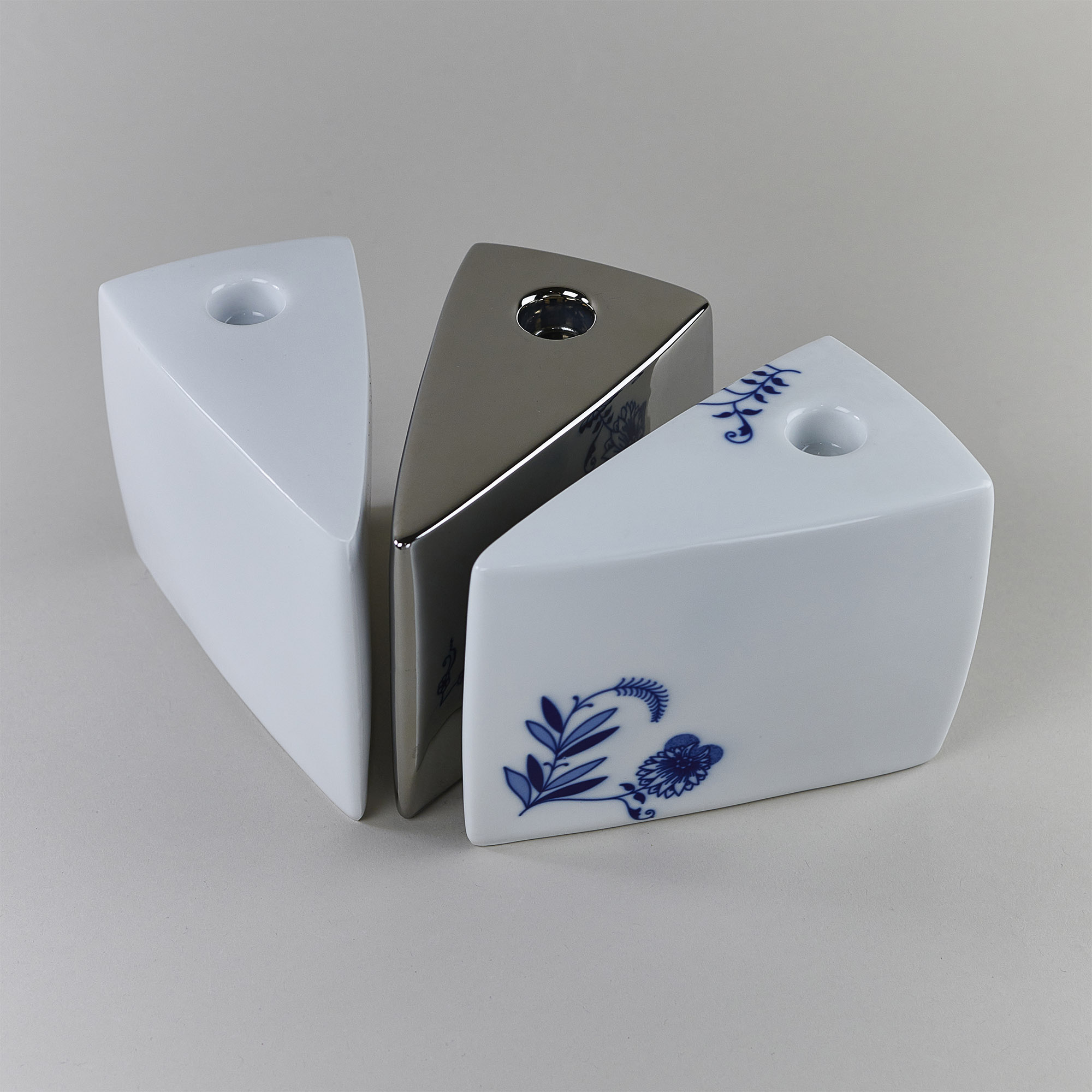 White, silver and onion pattern porcelain candleholder in a shape of a piece of cake by Qubus design studio