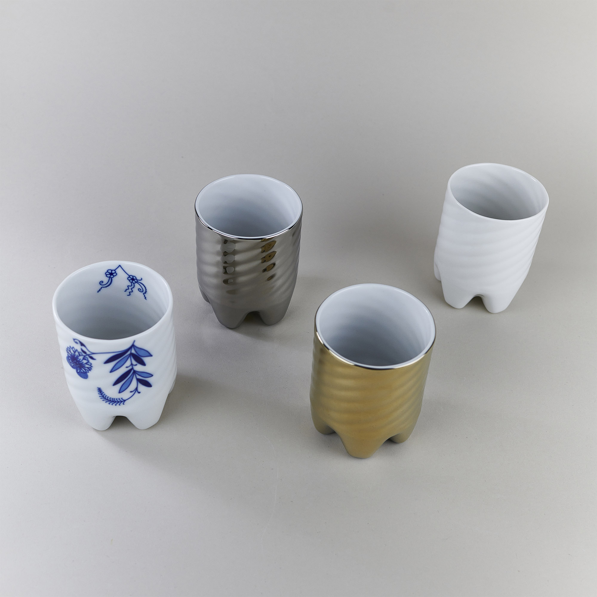 White, gold, silver and onion pattern porcelain cups by Qubus design studio