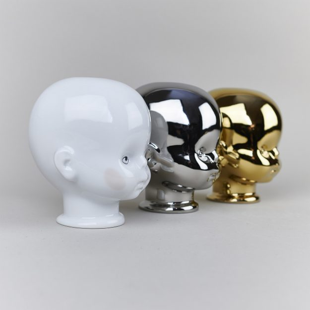 Small porcelain candleholders in a shape of a skull in gold, silver and white porcelain by Qubus design studio