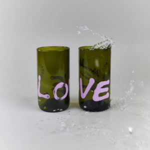 Recycled green glass with pink graffiti saying love by Qubus design studio