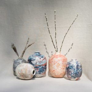 Colourful marble-coloured ceramic vases by Veronika Svabenikova