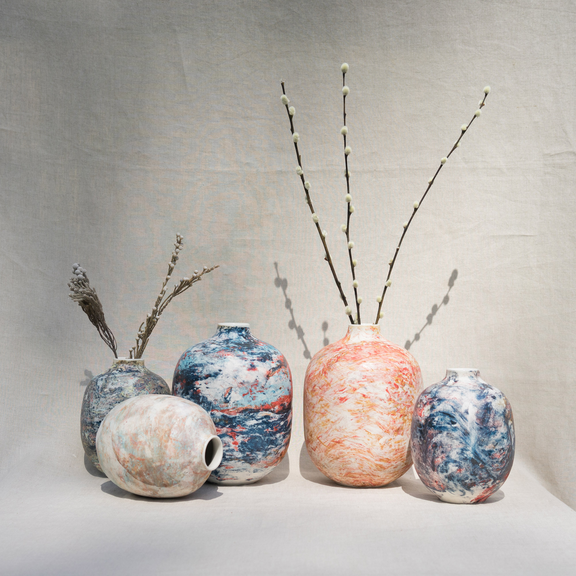 Colourful marble-coloured ceramic vases by Veronika Svabenikova
