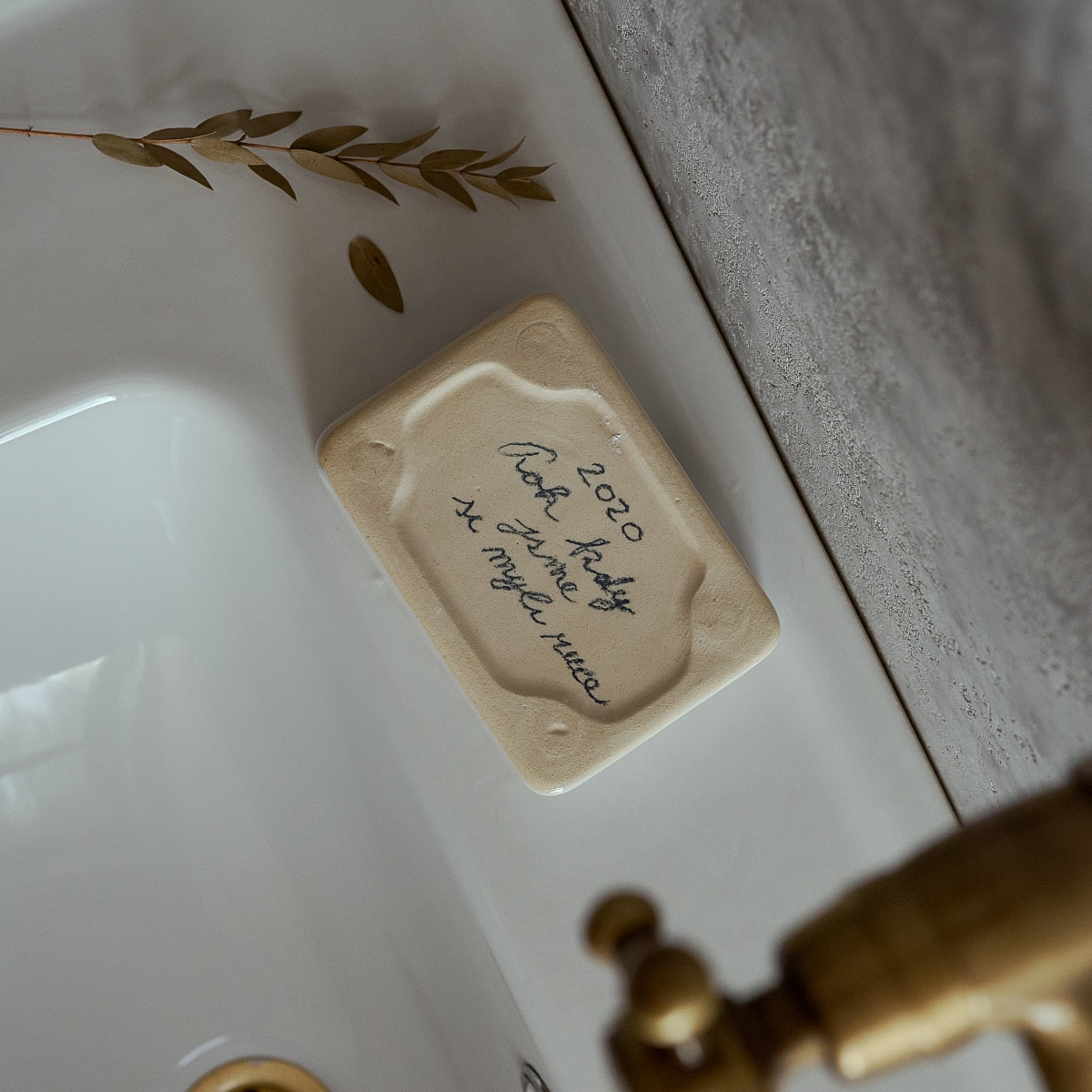 White porcelain soap dish by Milan Pekar with a soap