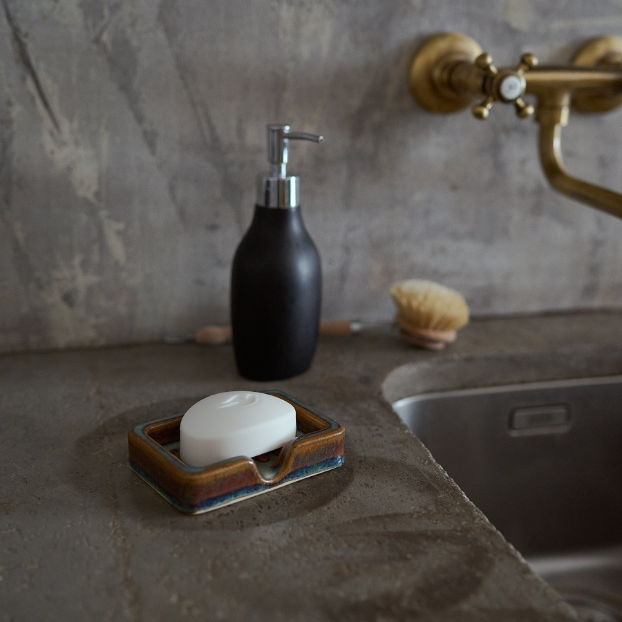 Brown porcelain soap dish by Milan Pekar with a soap